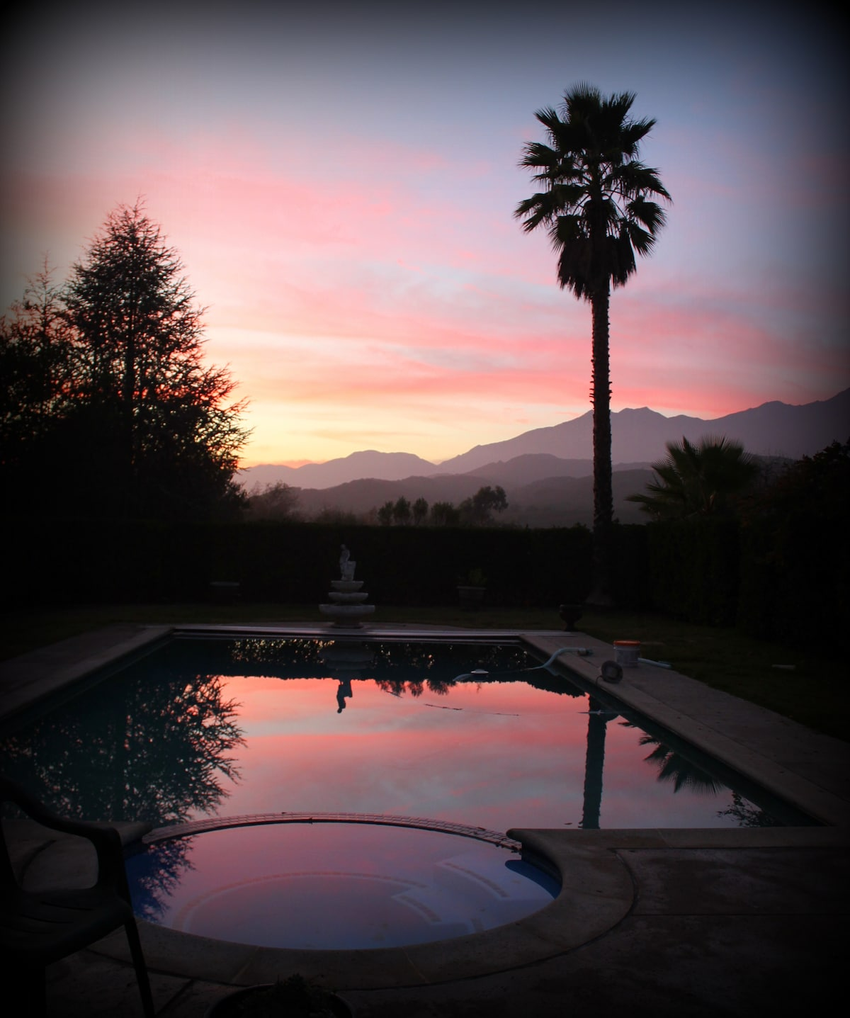 Sunset view from the deck of the pool and mountains.