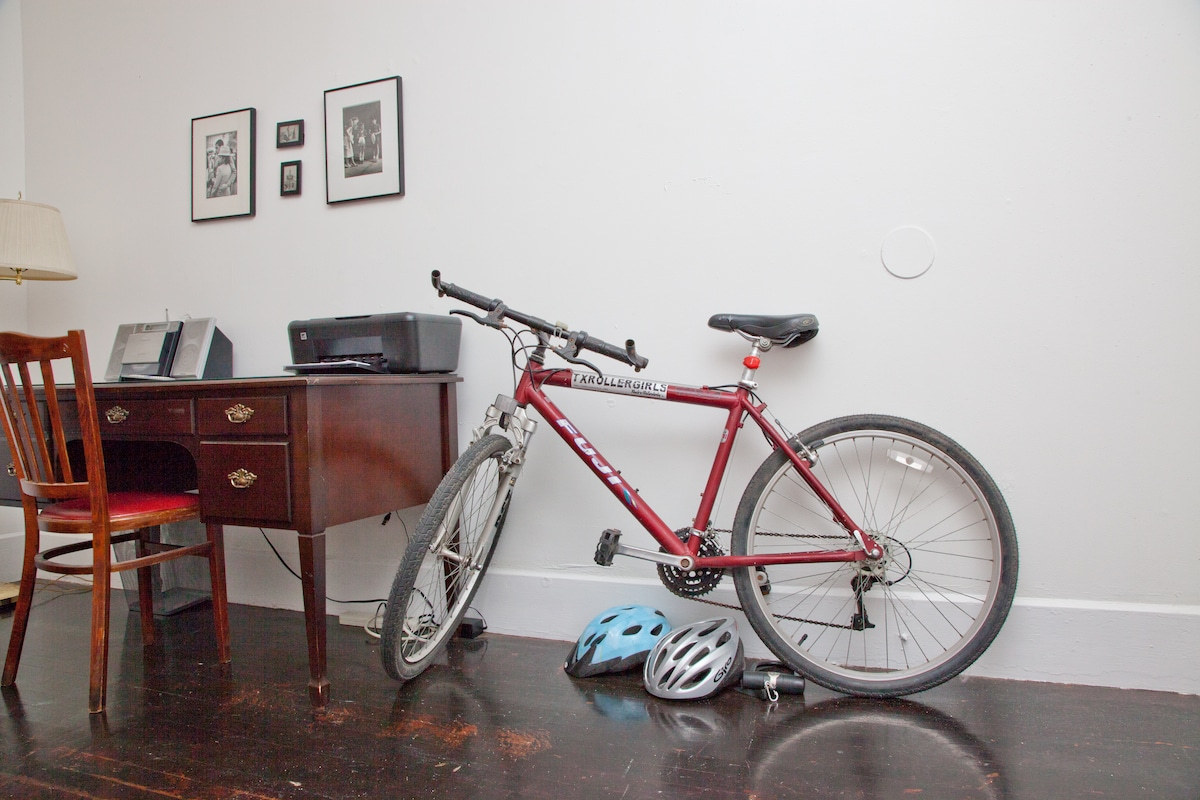 Desk, stereo/CD player with audio cable, bikes with lights/lock and helmets