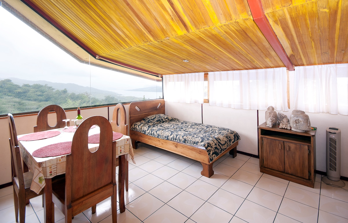 Photo is of the 'Sky Bungalow' which is one of the Papuga Rooms and connected by a breezeway to the deck and main rooms. A self contained space with private entrance kitchenette/1bath/1br -sleeps up to 5 on this side of house
