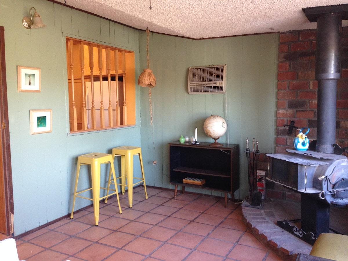 den off kitchen with wood stove