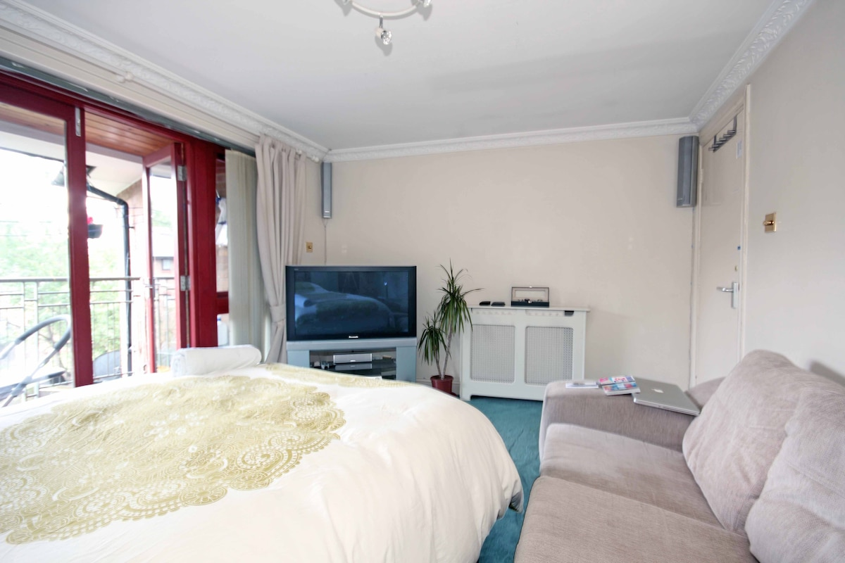 Watch TV/DVD from bed on a large screen with surround-sound.