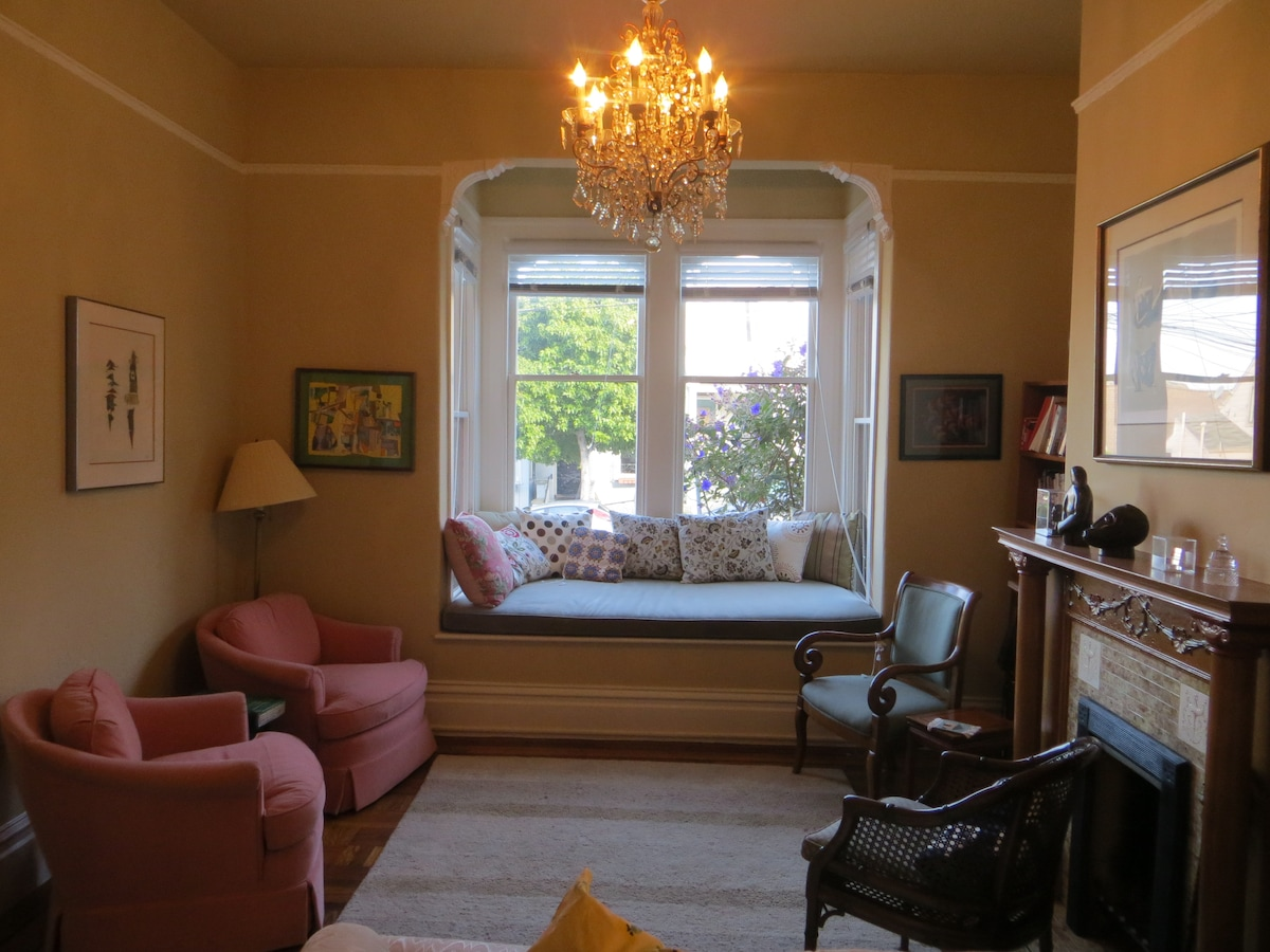 Living room in front of apartment with sunny window seat
