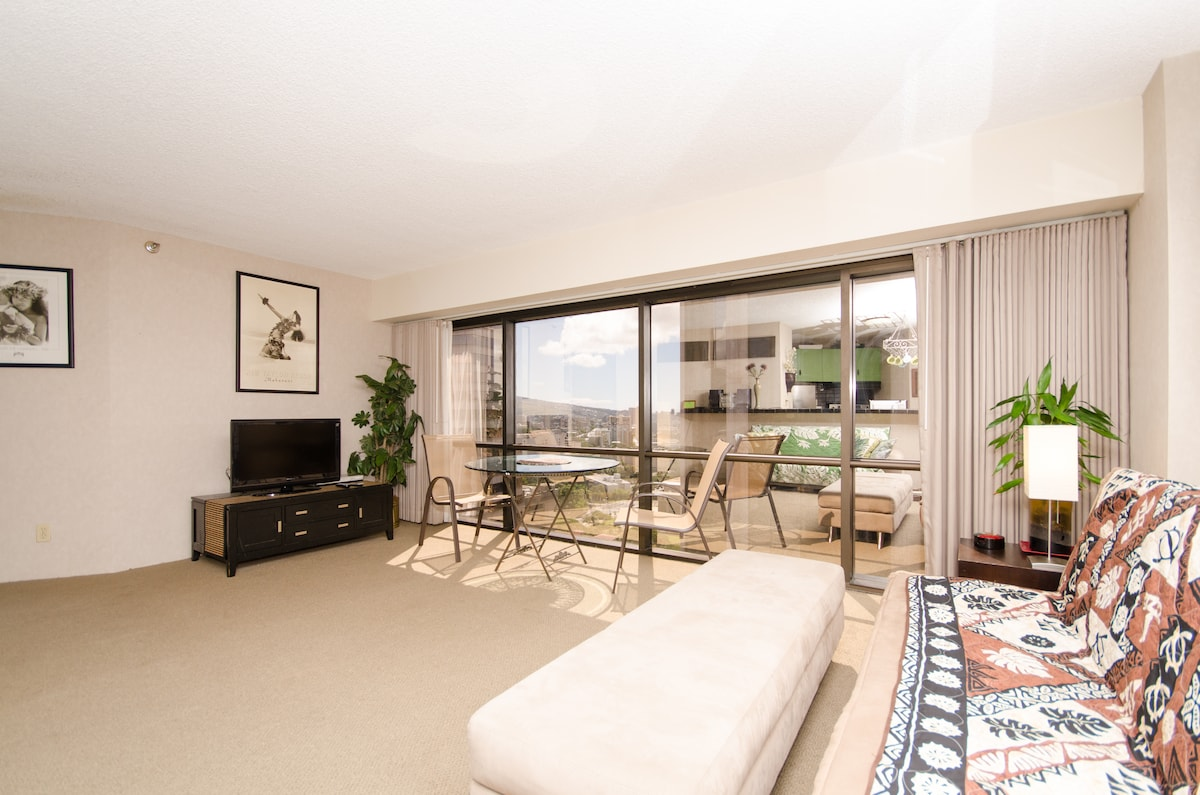 Spacious living room with TV, dining table, sofabed and a nice view.