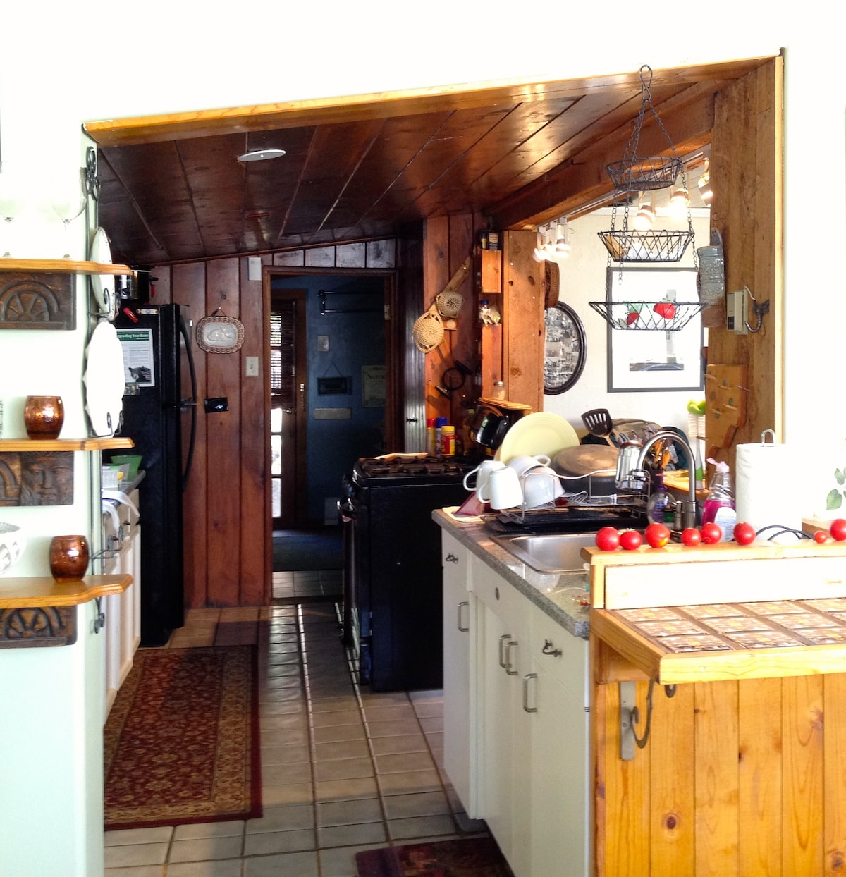The galley styled kitchen features a new (2012) 5- burner, convection oven stove with griddle and a full size refrigerator (2012) with ice maker.