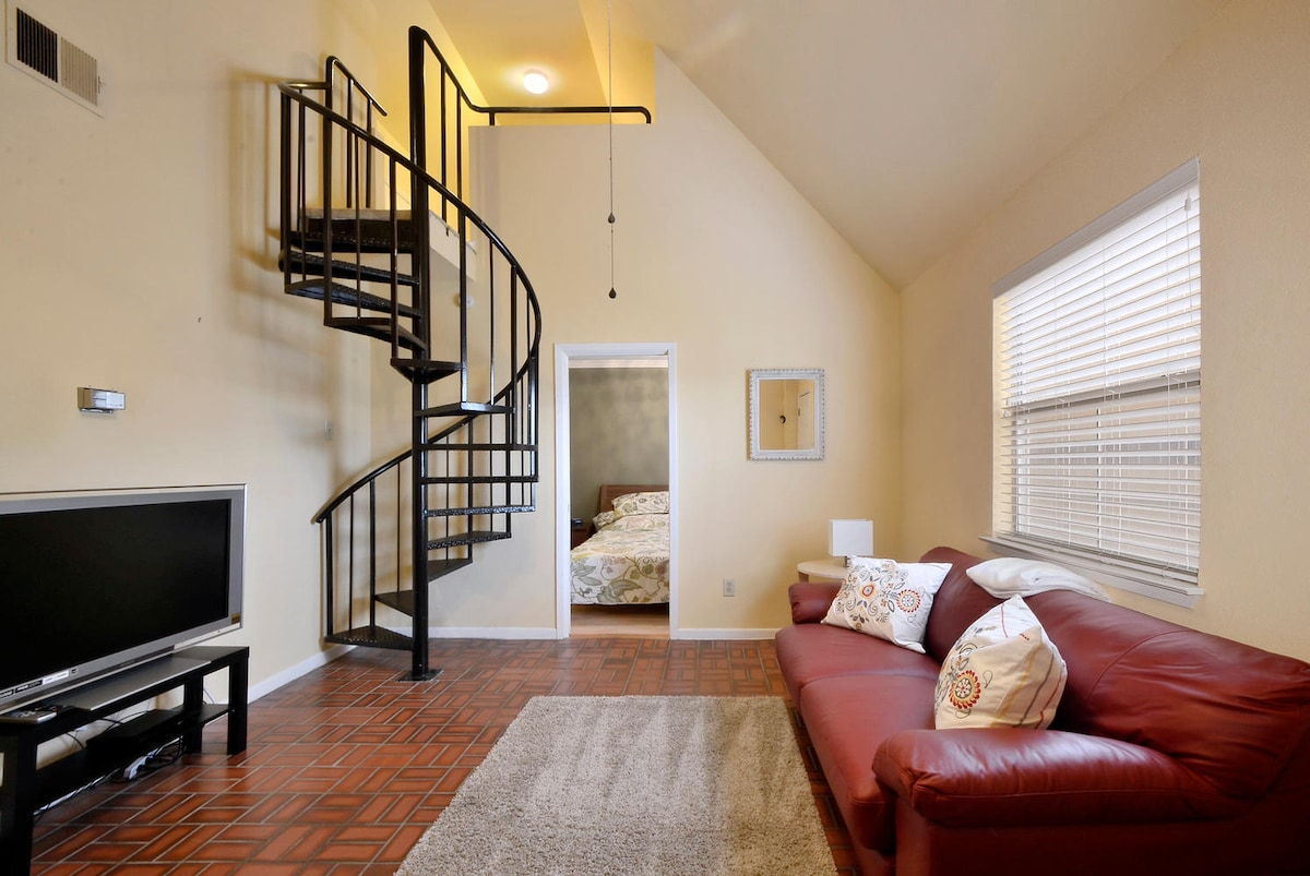 A fun spiral staircase is just one of the many pieces of eye candy to be found in this ultra hip Austin pad.
