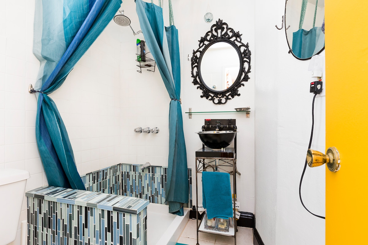 Sweet little bathroom!  Towels and little hotel bottles provided.