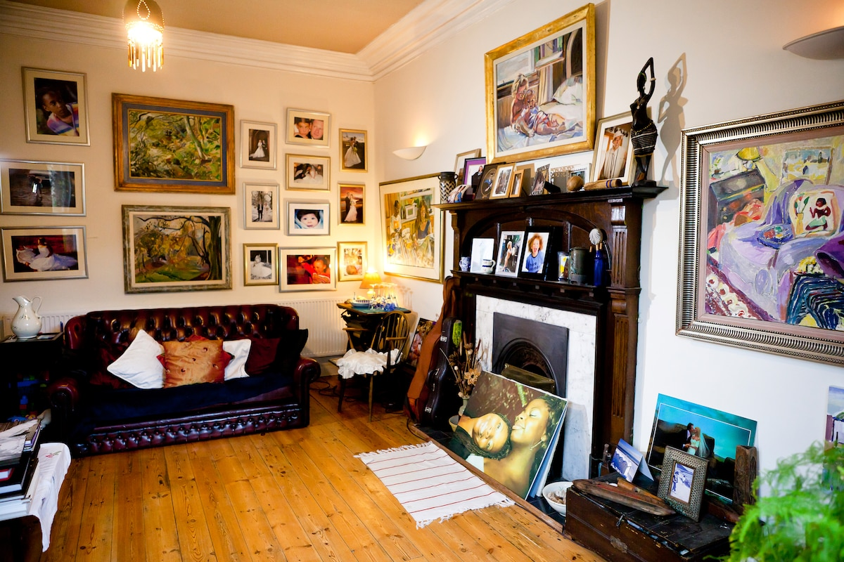 The front room, full of my  paintings and photos.