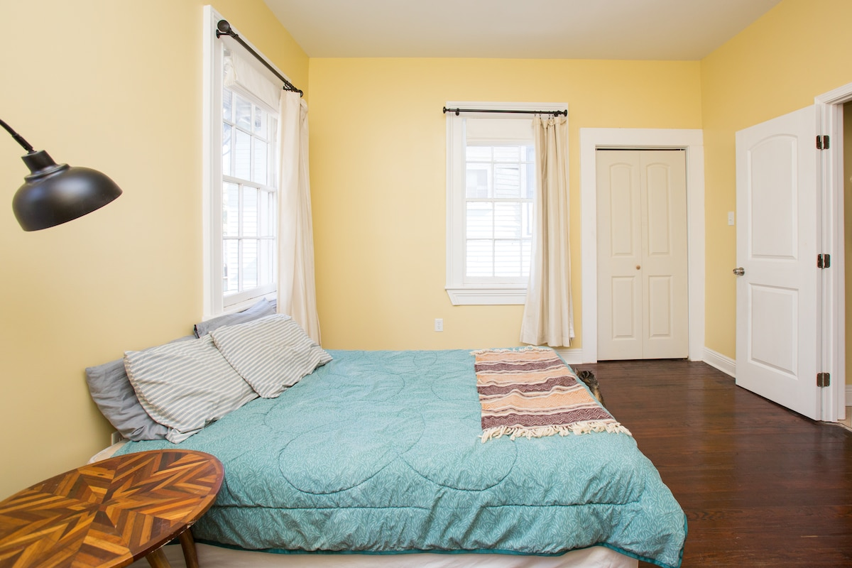 your bedroom with lots of windows and beautiful sunlight