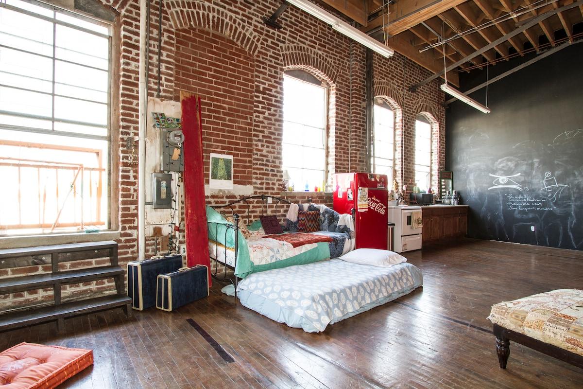 Backpackers Dream in Artists Loft