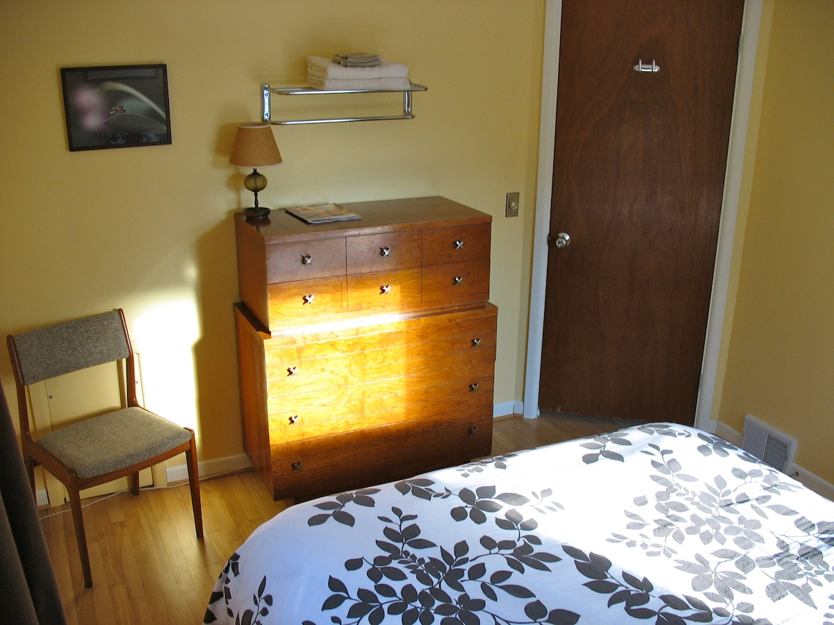 Your room, with fresh towels and bureau for your use.