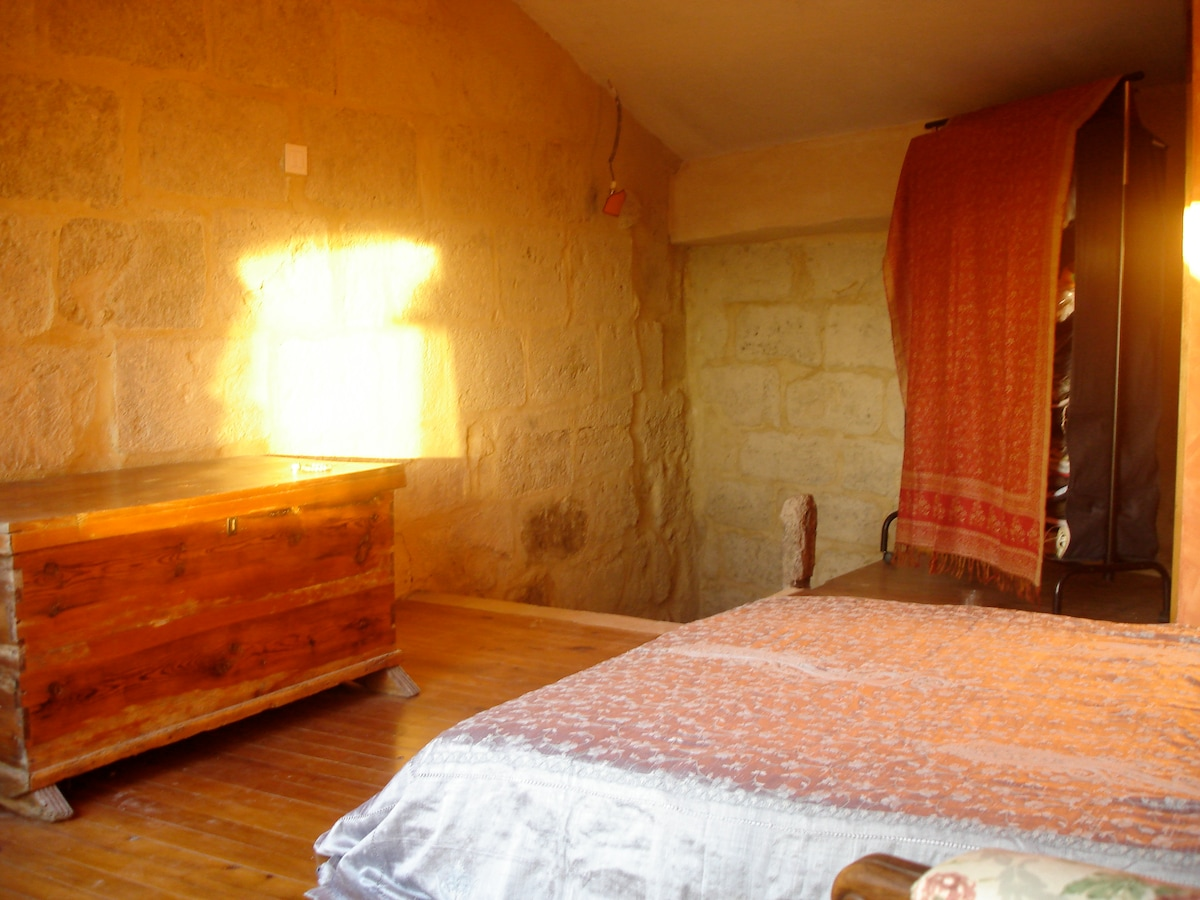 beautiful light of the sunset on the stone wall in the bedroom
