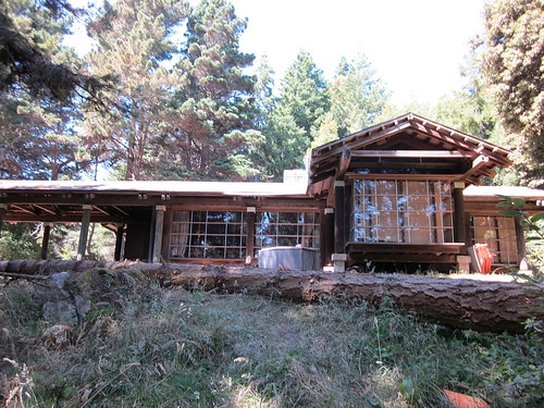 Dramatic redwood construction with walls of windows in almost every room.