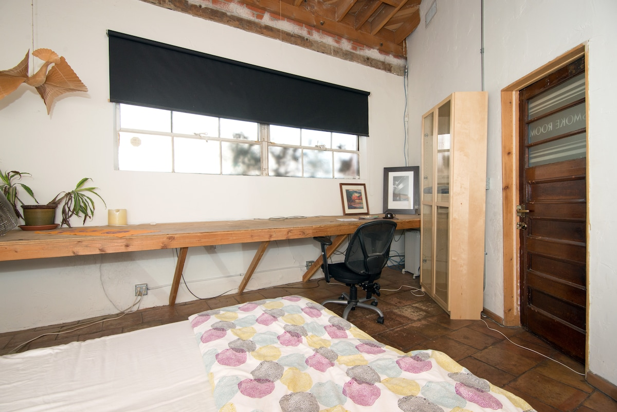Large window illuminates a 15-foot built-in desk/counter.