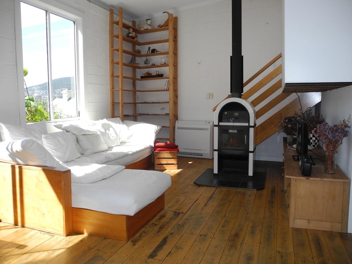 Inner third of the loft. The wood heater no longer works - but it still looks good.