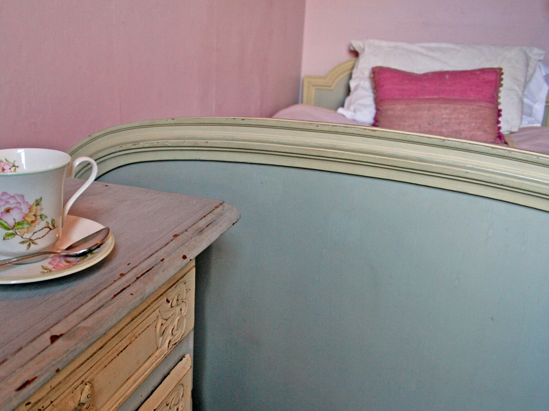 "Belle Isle is a single room decorated with calm Laura Ashley colours and French country antique furniture. A larger than normal 3'6"" wide bed is topped with a thick bespoke mattress for an excellent night's sleep. There is a small shower en-suite."