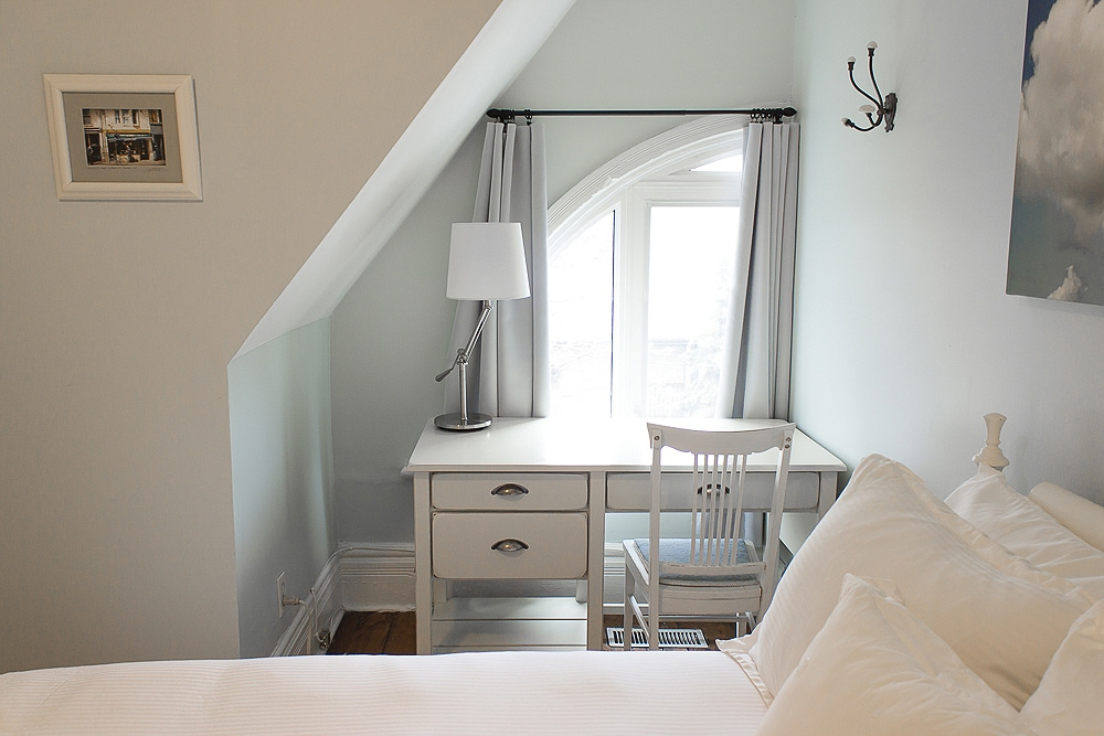 Tastefully-appointed private bedroom with standard (double) bed and laptop workstation by the window, with access to wi-fi internet.