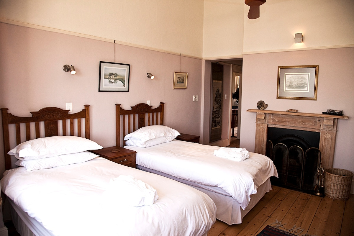The large master bedroom has extra-length twin beds