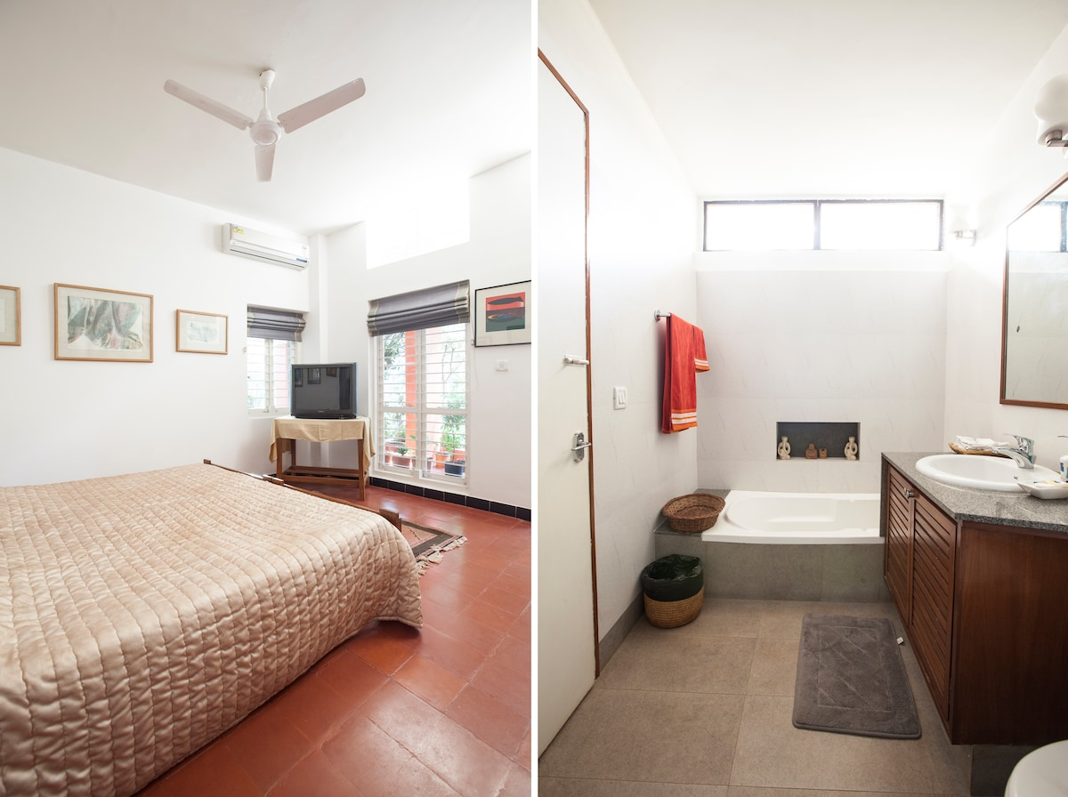 The 'Outer room', with Television and Air Conditioner, private entrance and attached bathroom.