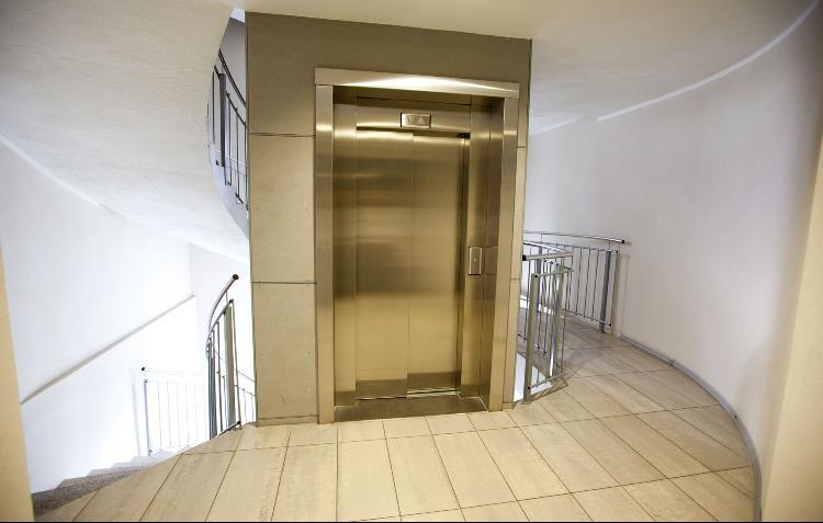 Elevator which leads to upper level apartments