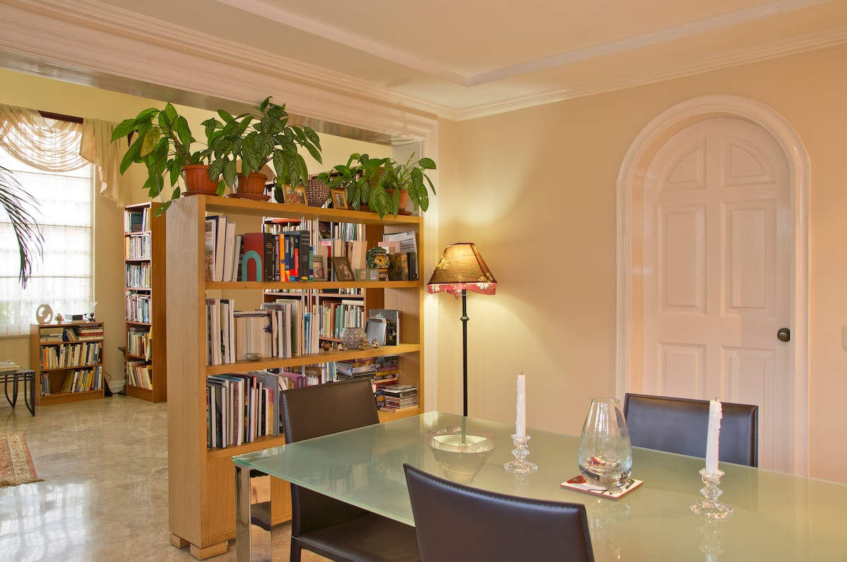 Dining room -- books are everywhere in the home