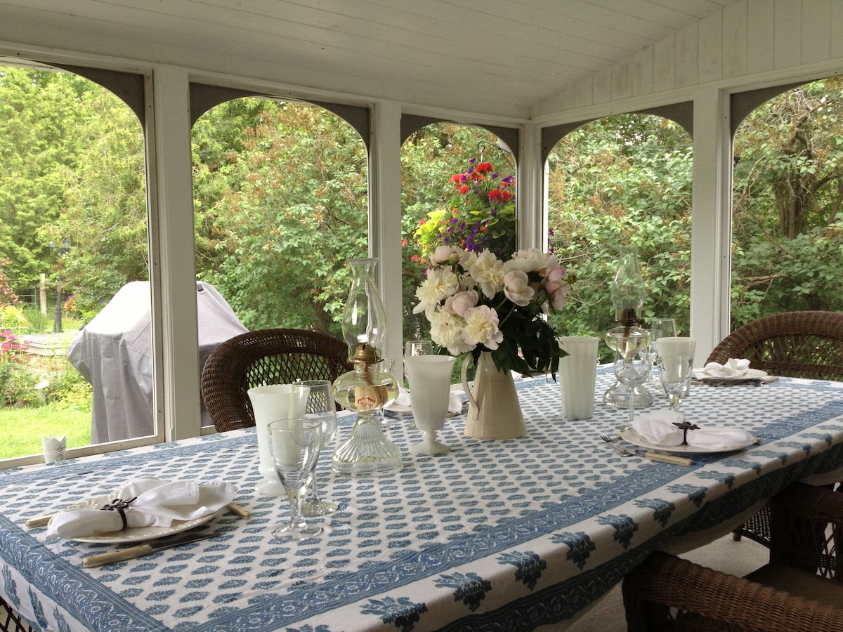 Screened in porch - perfect for summer dining.