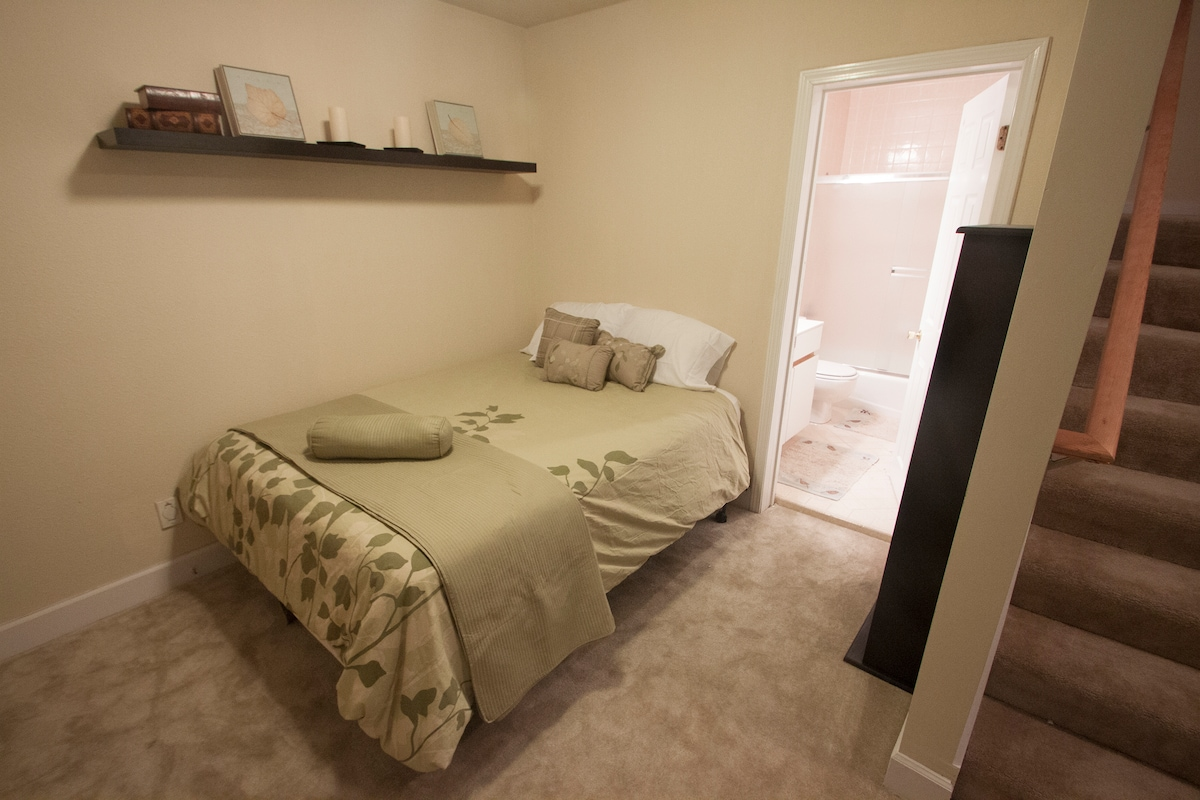Your queen bed has high thread count linens and a warm down comforter, right next to your private bathroom.