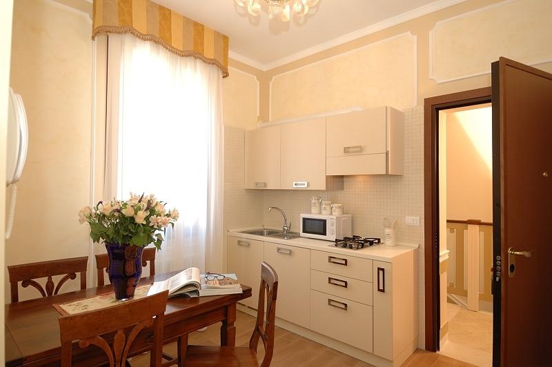 zona giorno con angolo cottura - dining room with kitchen corner