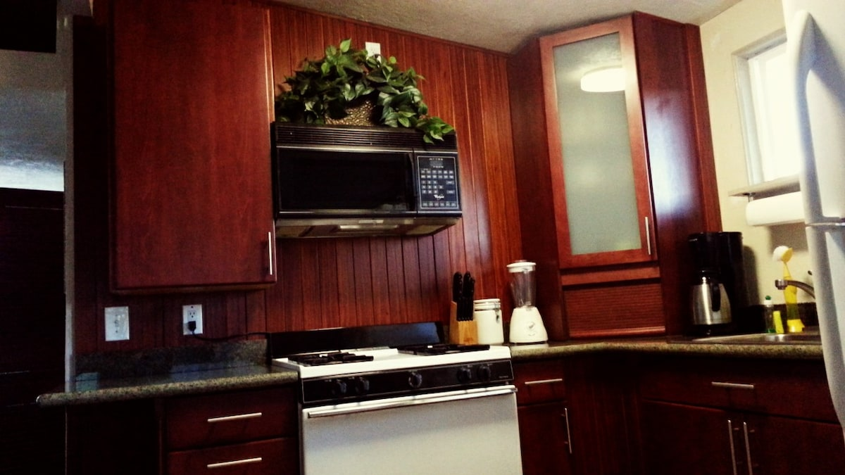 Newly remodeled fully equipped kitchen with granite countertops