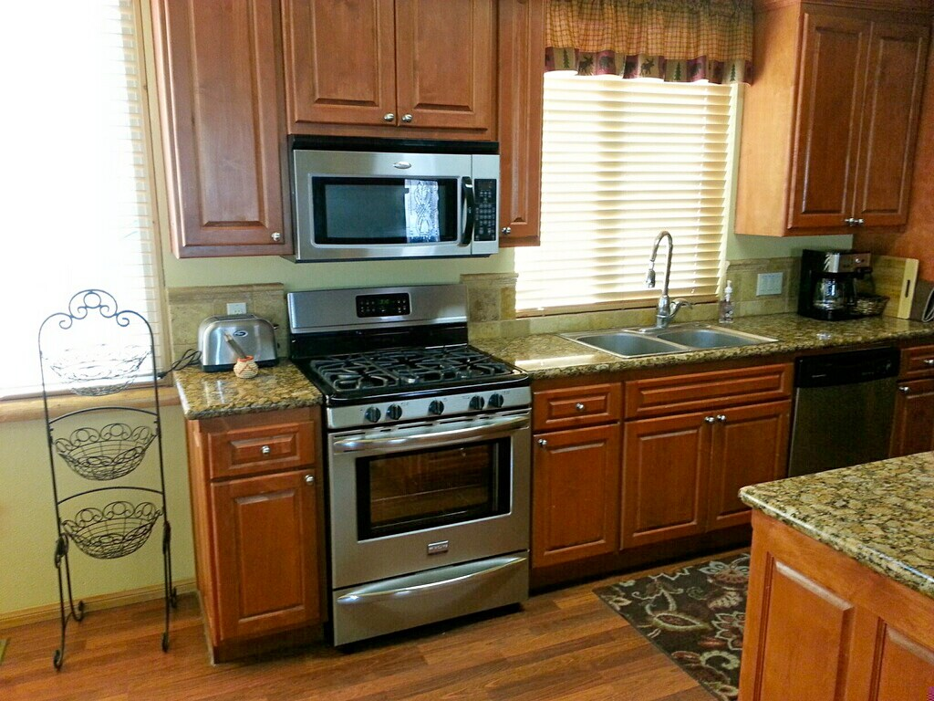 Kitchen with microwave, 4 burner gas stove/oven and dishwasher.