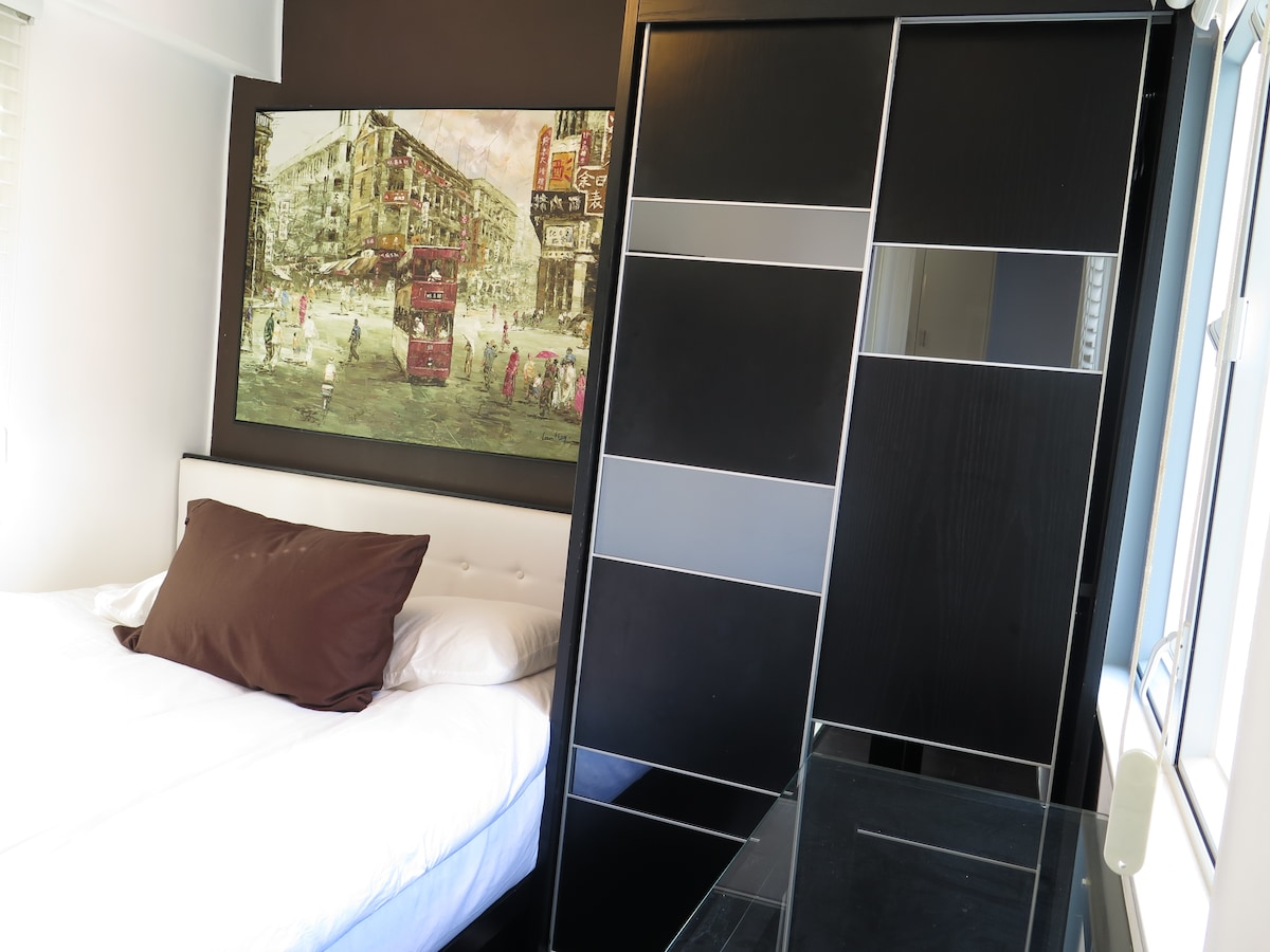 The bedroom has a built-in queen size bed & an ample wardrobe space