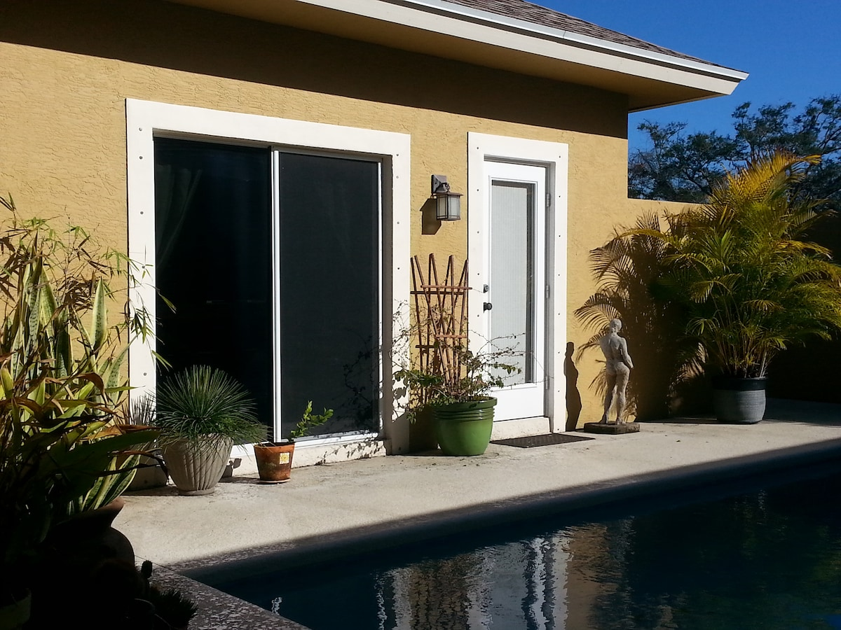 Sliding glass doors lead from the guestroom out to the Courtyard & Pool