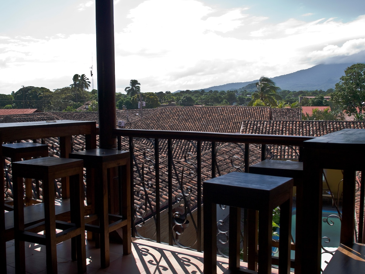 On the terrace of the villa overlooking volcano, nature and city