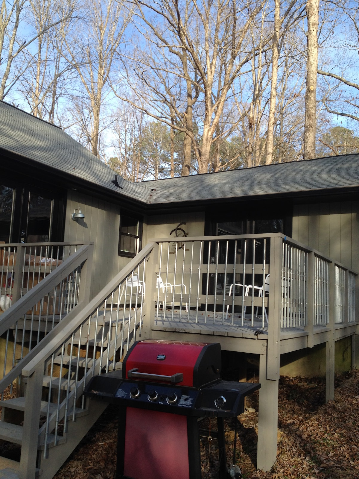 The deck is accessible from great room, master suite and large fenced-in back yard. Catch some rays or star gaze.