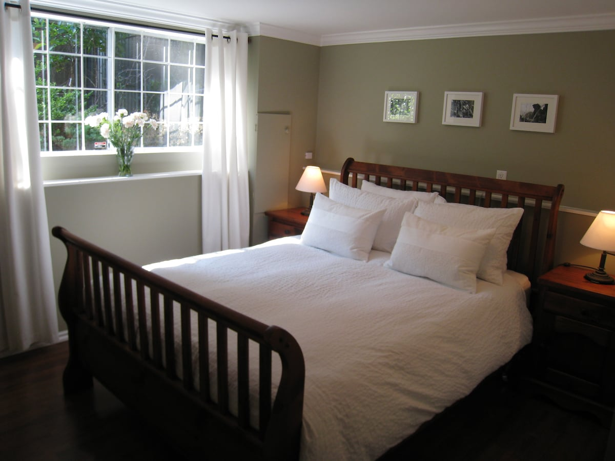 Bedroom with queen size bed.  Built-in closets are off the right (out of view in photo).  Again, private garden aspect.