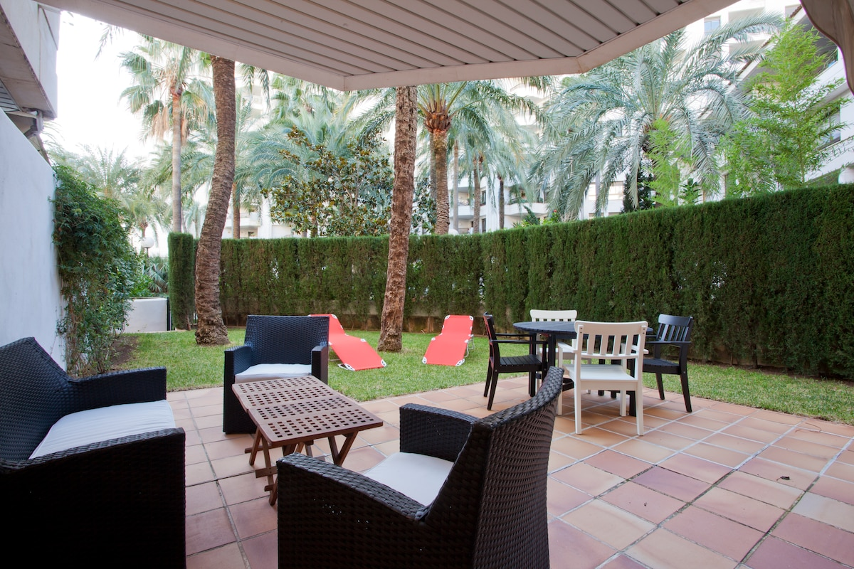 Private Garden with chill out area, dinning table and sun lodgers.