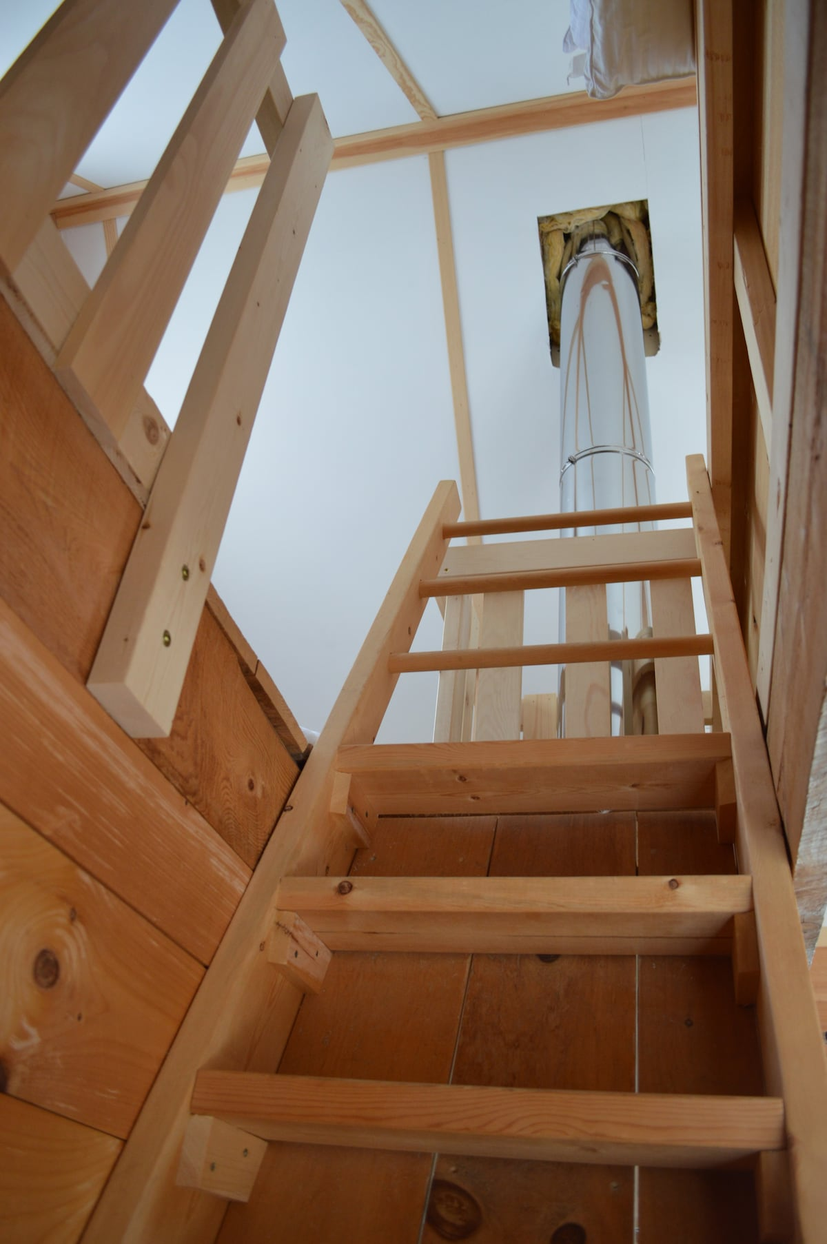Ladder to sleeping loft with double bed.