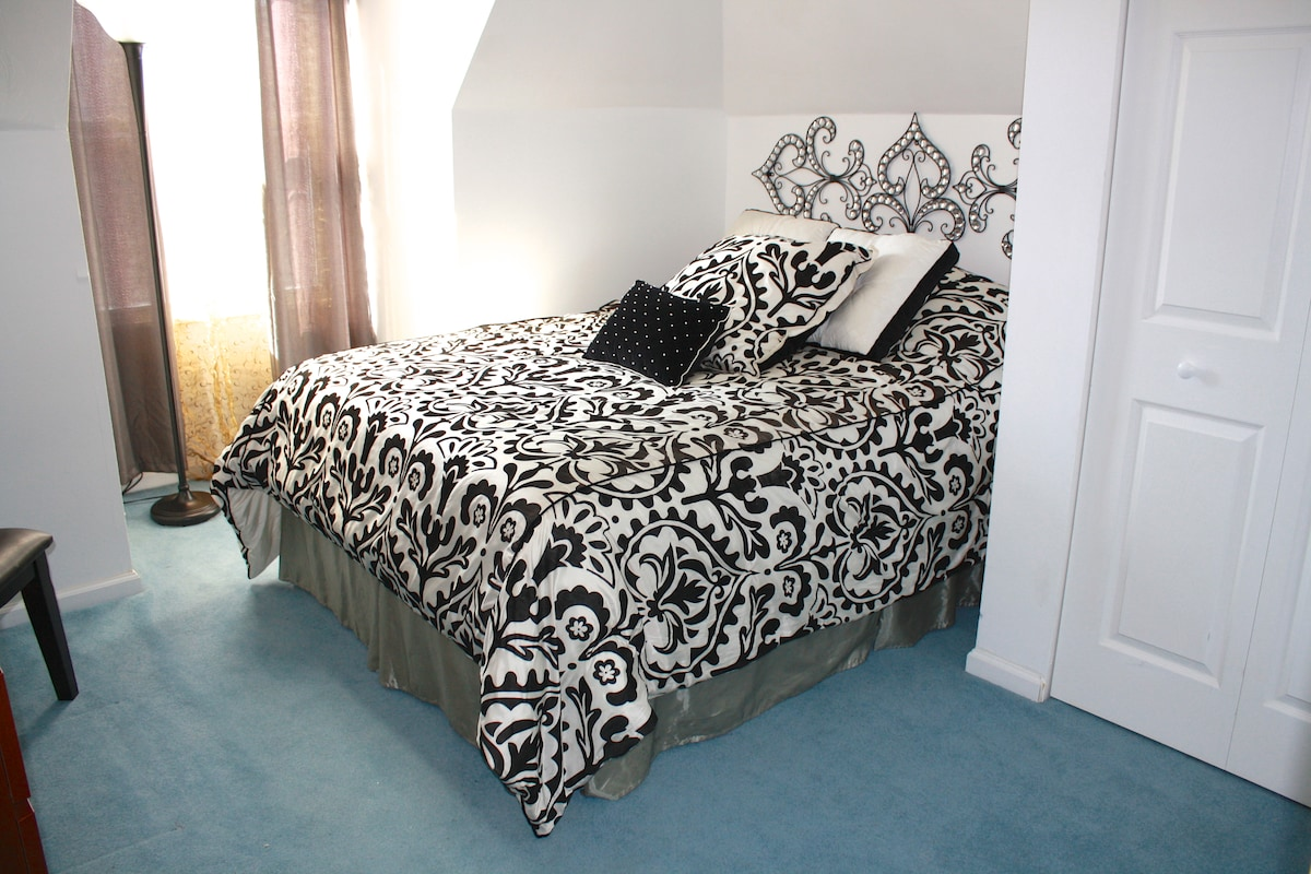 The first of two beautiful bedrooms - each with pillowtop Queen mattresses, 100% organic cotton sheets and beautiful comforter and pillow sets