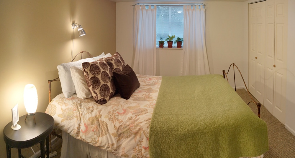 Queen sized bed with down comforter provides restful sleep for your big adventures.