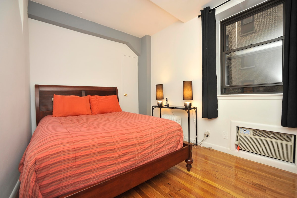 Separate Bedroom with queen size bed, air conditioning, and plenty of closet space