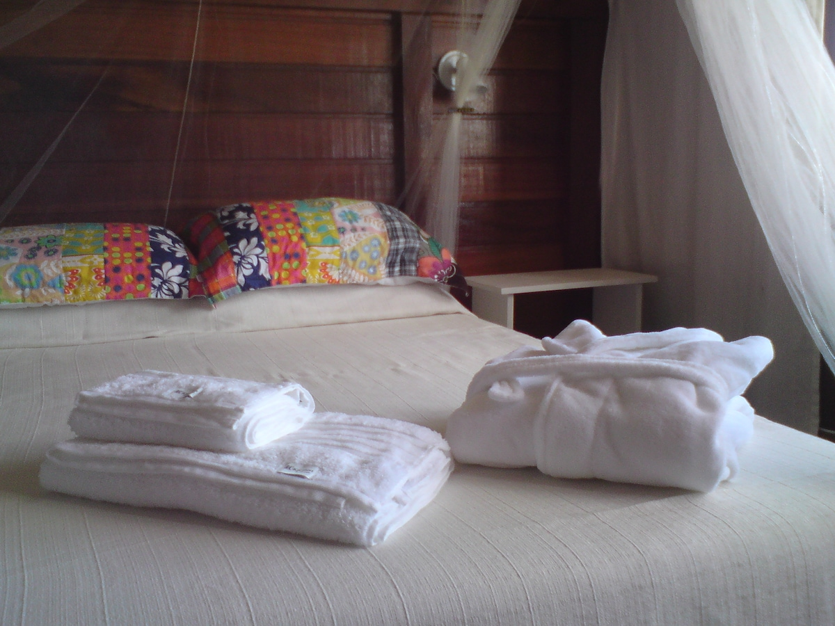 Double room on first floor with private bathroom on ground floor.