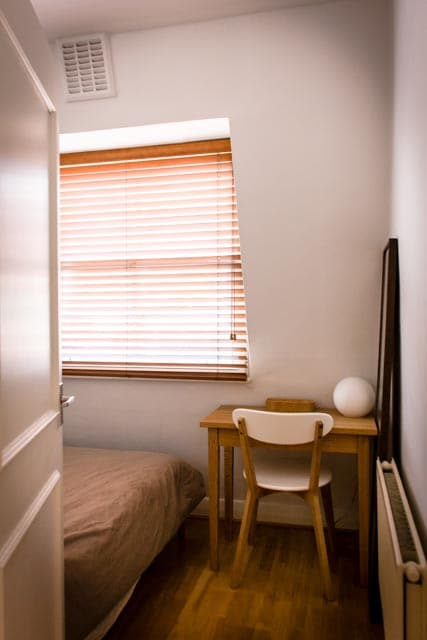 Bedroom with double bed, and Muji desk.
