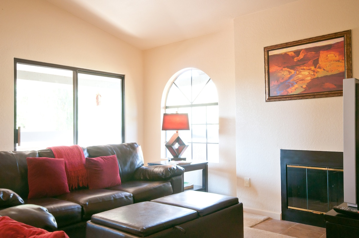 Living room with fireplace, new flat screen Smart TV, Stereo, DVD.