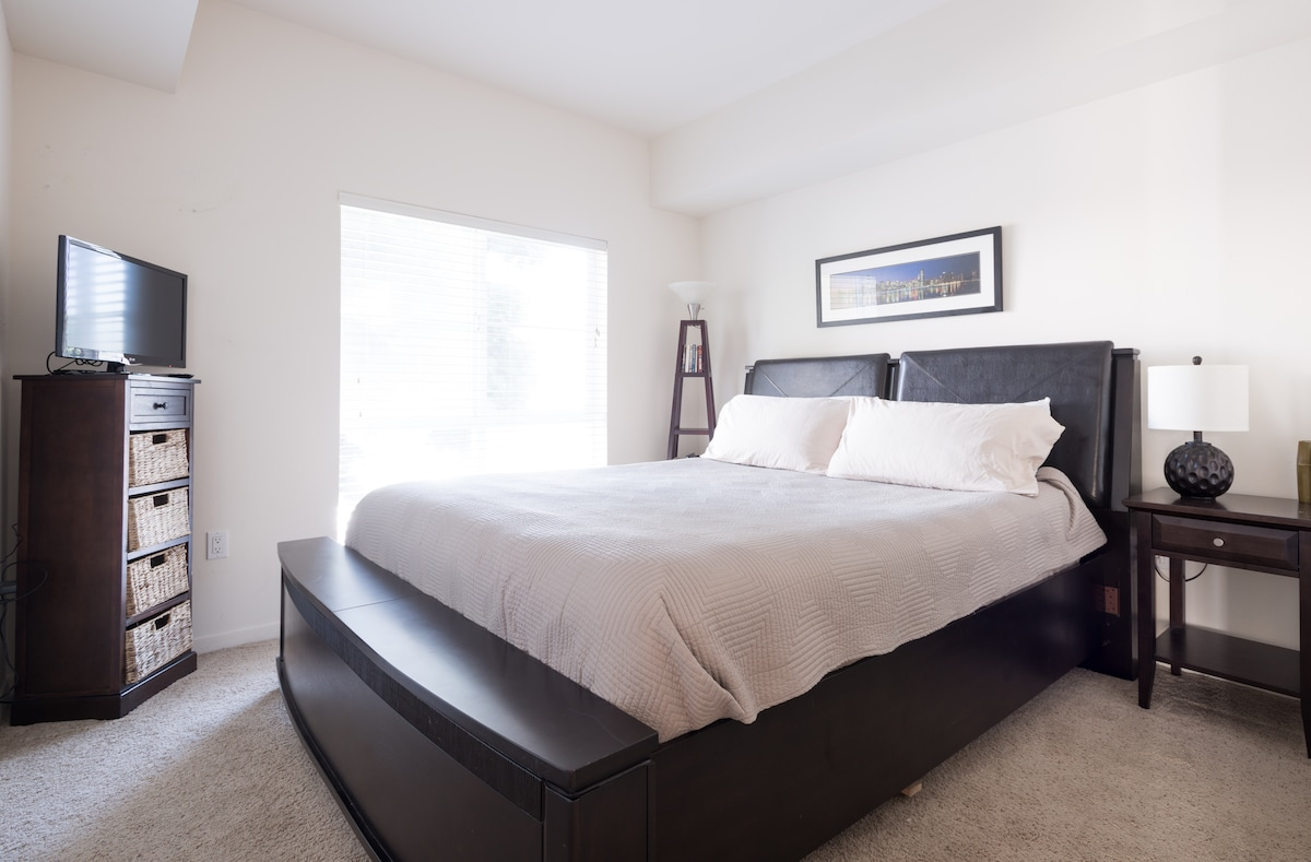 Large pillow top Cali-King bed w/ TV