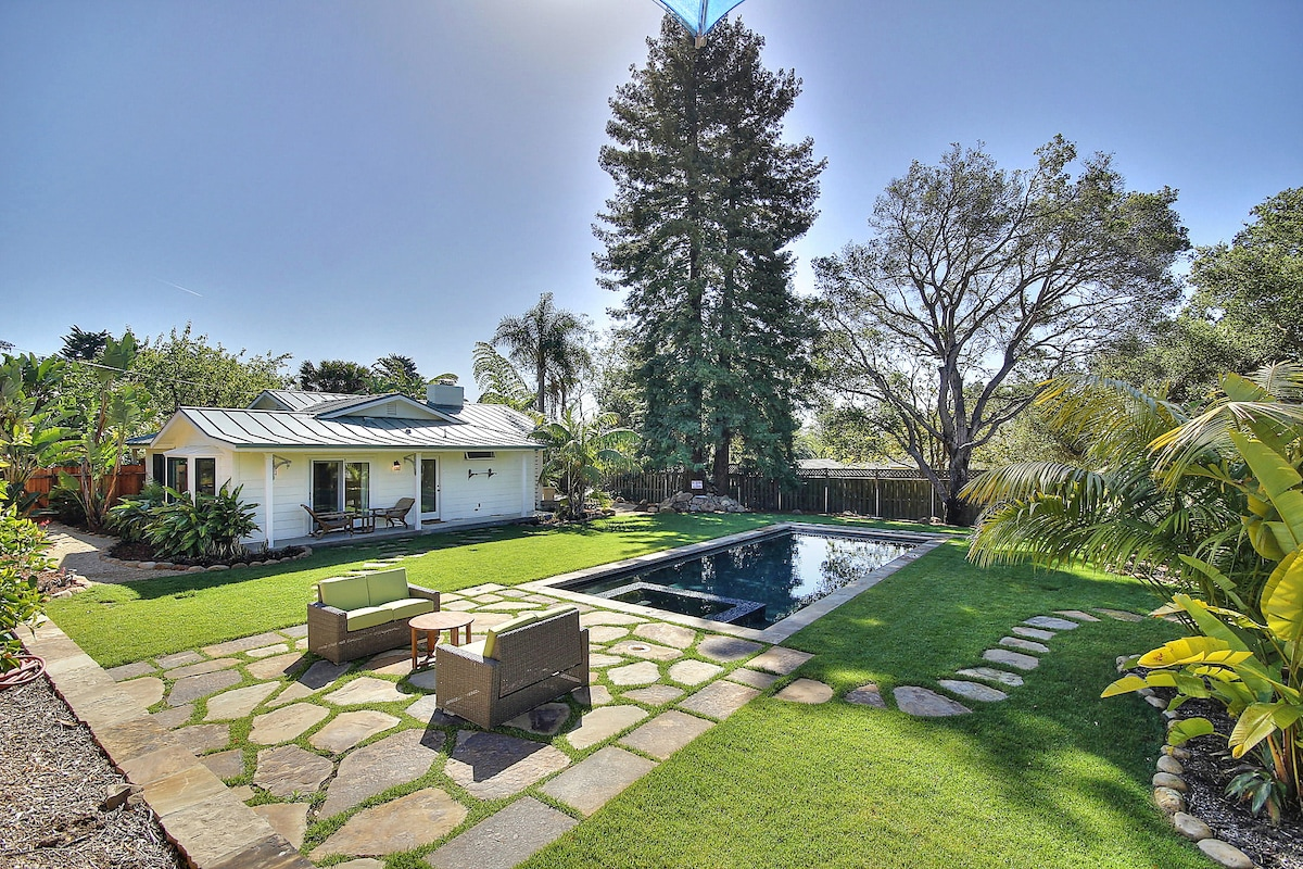 The plush landscaping from front to back is breathtaking and the trees surrounding our home provide natural shade.