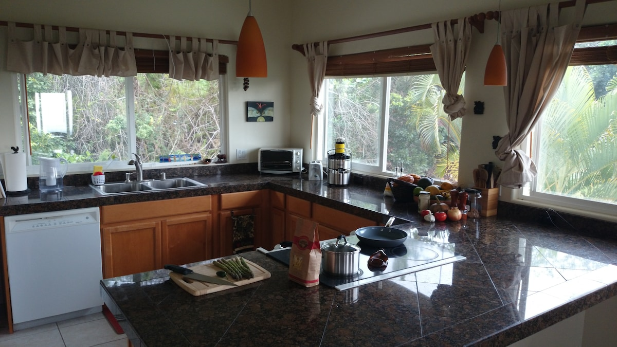 Full kitchen with windows on three sides. Watch the sun set on the ocean while cooking, if you like.
