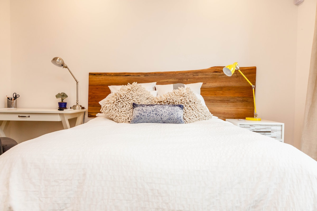 Luxury furniture, bedding and top notch features makes this private apartment a perfect rest stop.