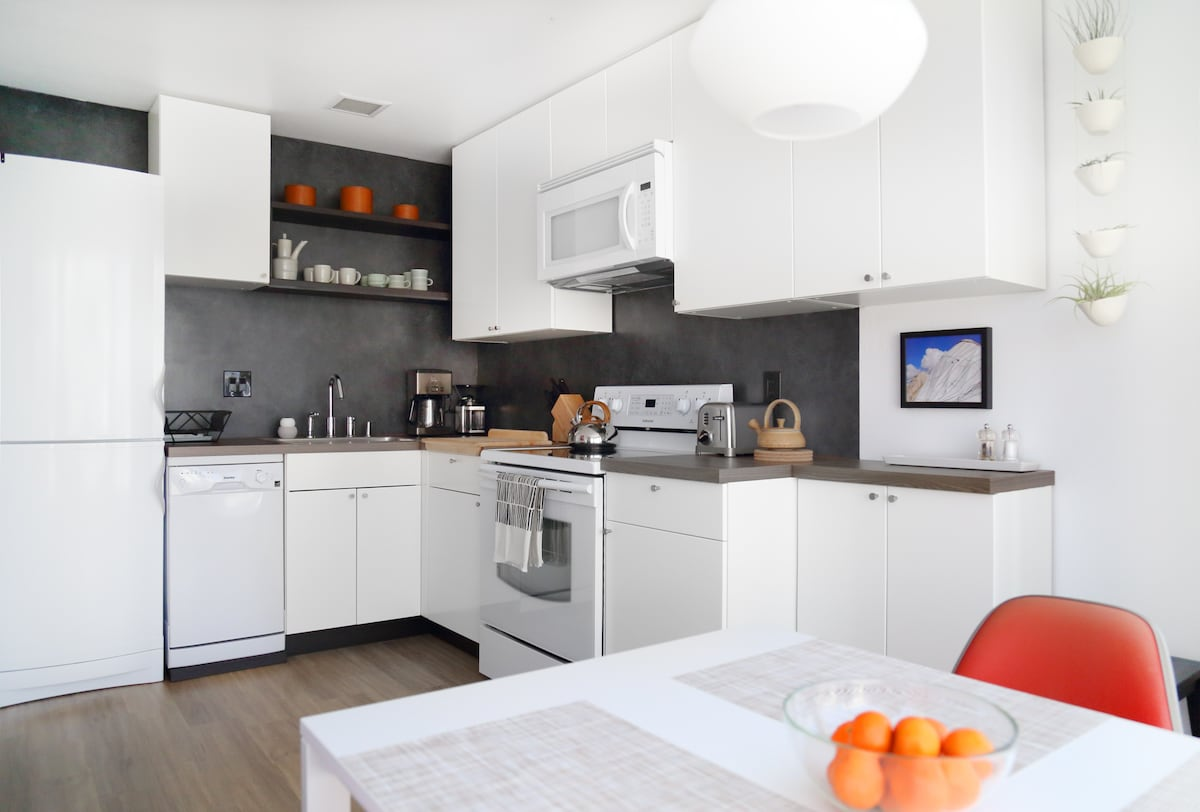 The kitchen has been refreshed top to bottom, with all brand new appliances - fridge, dishwasher, range, microwave, toaster, burr coffee grinder and auto pour over coffee maker await.