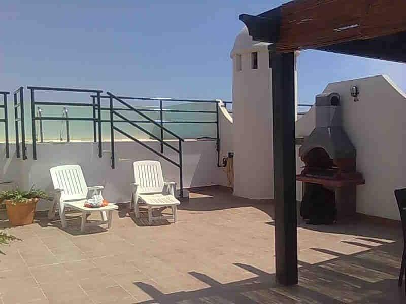 Atico con piscina privada en playas de vera for Atico con piscina privada