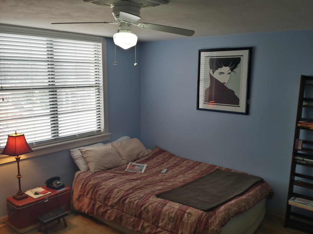 This is your master bedroom. It measures 400 sq. ft and has a fully-adjustable custom air mattress for a comfortable night's sleep.  Sheets, blankets, pillows and towels are provided.