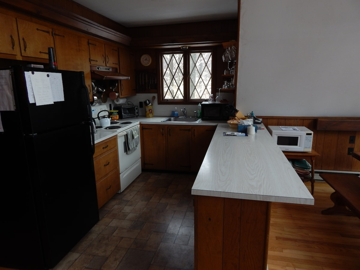 Kitchen fully-stocked with dishes, glasses, utensils plus DW, coffeemaker and microwave